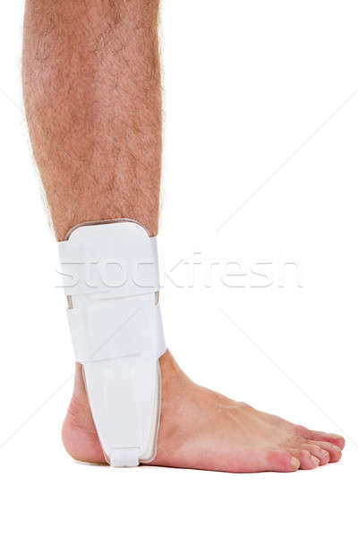 Profile of Man with Bare Foot Wearing Ankle Brace Stock photo © belahoche