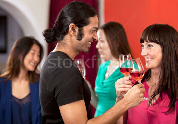 Flirting over a glass of wine.  Stock photo © belahoche