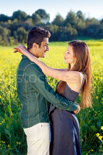 Affectionate young couple in a loving embrace Stock photo © belahoche