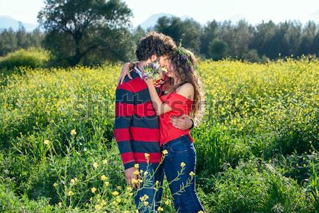 Loving young couple in a rapeseed field Stock photo © belahoche