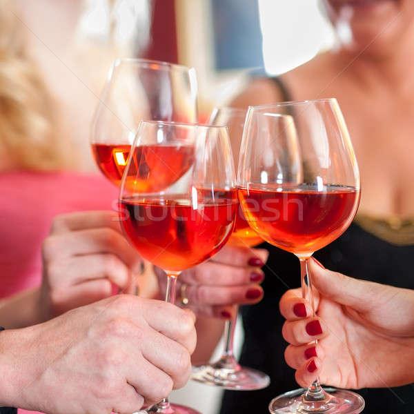Stock photo: Hands Raising Glasses of Tasty Red Wine