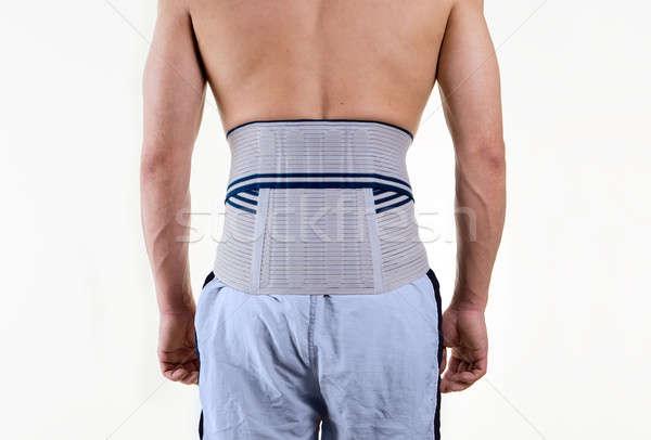 Shirtless man ondersteuning verlagen Maakt een reservekopie Stockfoto © belahoche
