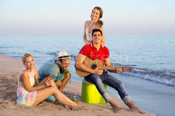 Young People Having their Vacation at the Beach Stock photo © belahoche
