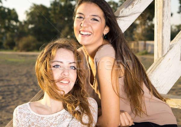 Sorridente bastante meninas ventoso tarde Foto stock © belahoche