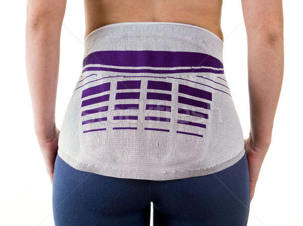 Athletic Woman Wearing Lower Back Support Brace Stock photo © belahoche
