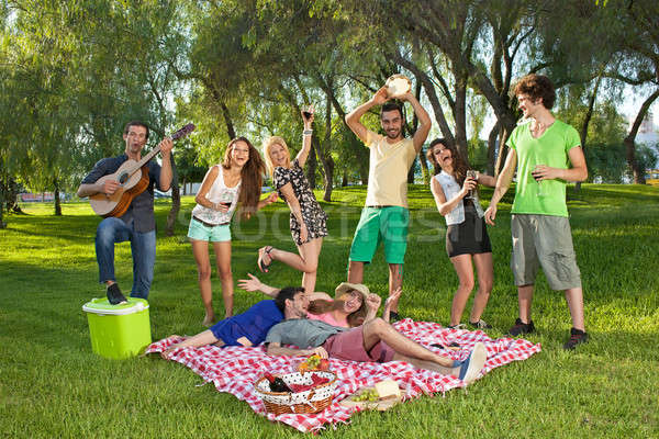 Lively group of teenagers in the park Stock photo © belahoche