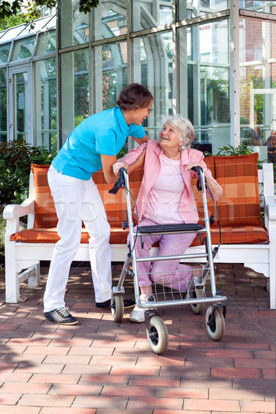 Senior lady with a care assistant or her daughter Stock photo © belahoche