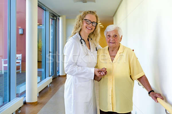 Nurse and Elderly Patient Smiling at the Camera Stock photo © belahoche