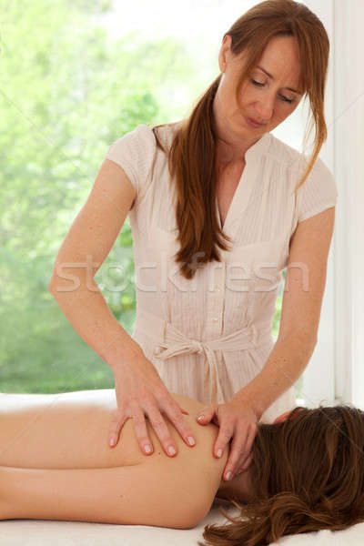 Alternative Practitioner Giving Massage Stock photo © belahoche