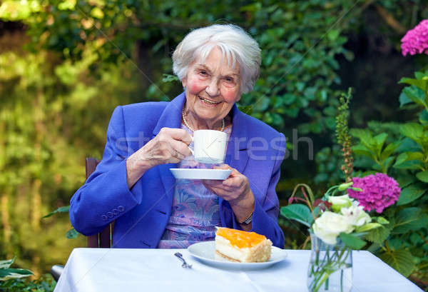 Happy Senior Woman in Coffee Time at the Garden Stock photo © belahoche