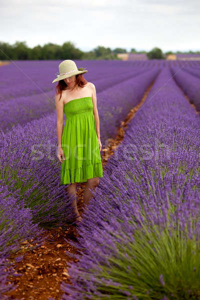 Romantic woman in green dress and hat standing in lavender field Stock photo © belahoche