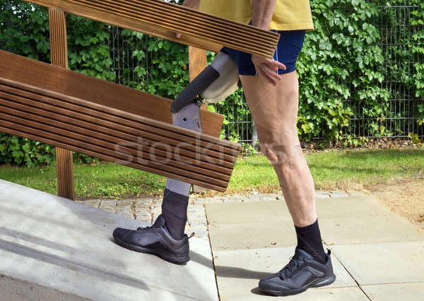 Unidentifiable man walking on ramp with false leg for exercise. Stock photo © belahoche