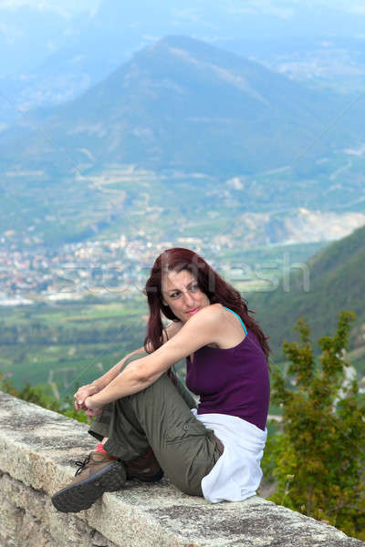 Woman sitting on a ledge. Stock photo © belahoche