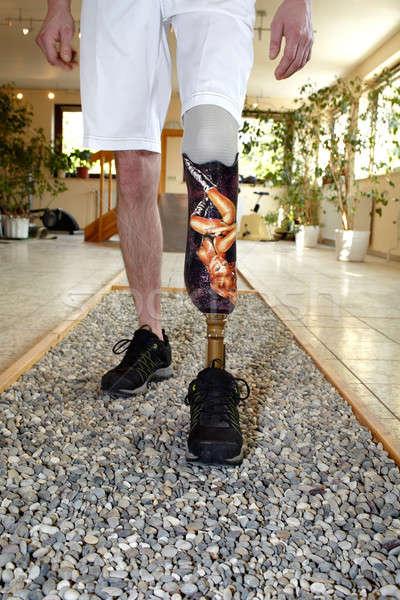 Male prosthesis wearer learning to walk Stock photo © belahoche