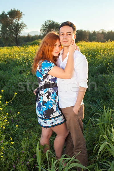 Affectionate young couple in the countryside Stock photo © belahoche