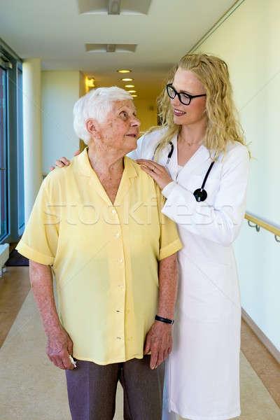 Nurse Talking to an Elderly Woman at the Corridor Stock photo © belahoche