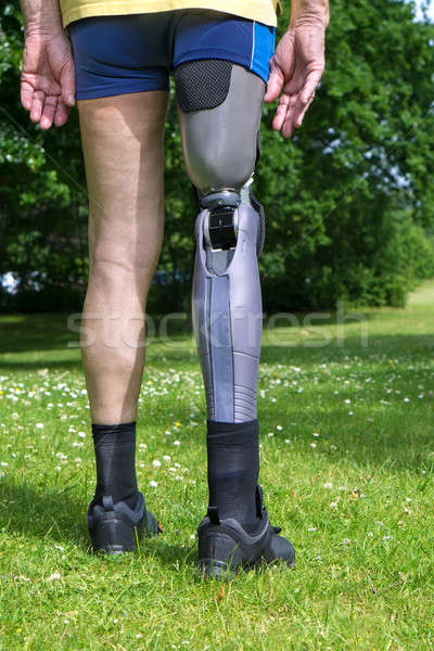 Rear view on false leg of man standing on grass Stock photo © belahoche