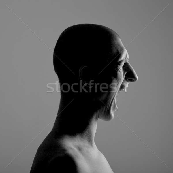 Urlando uomo ritratto faccia nero giovani Foto d'archivio © Belyaevskiy