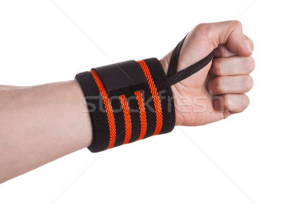 Hand gewichtheffer zwarte oranje pols ondersteuning Stockfoto © Belyaevskiy