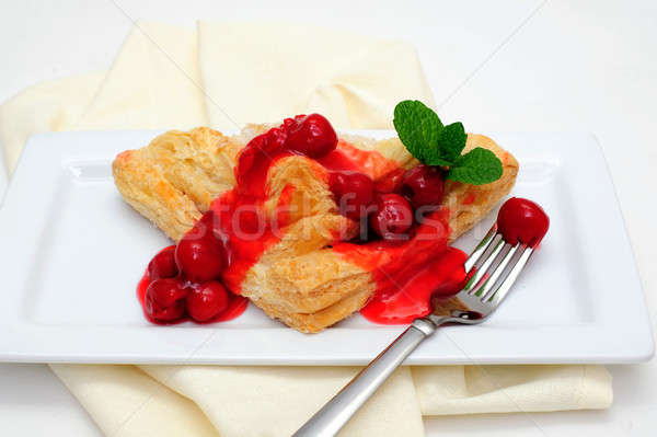 Turnover Topped With Cherries Stock photo © bendicks