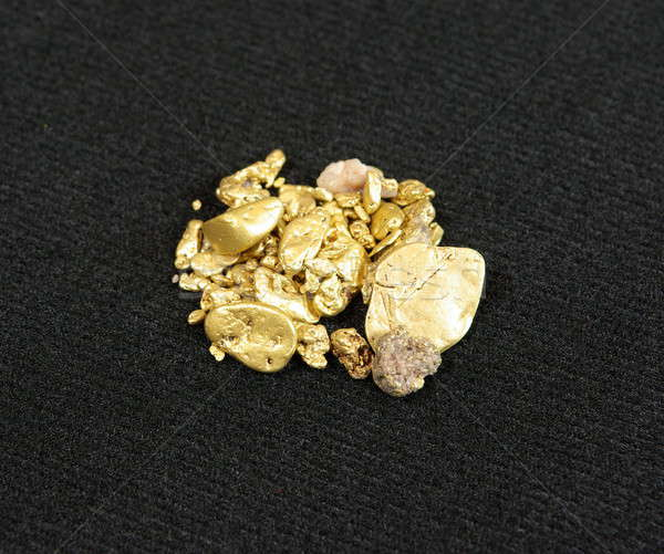Gold Nuggets On Black Stock photo © bendicks