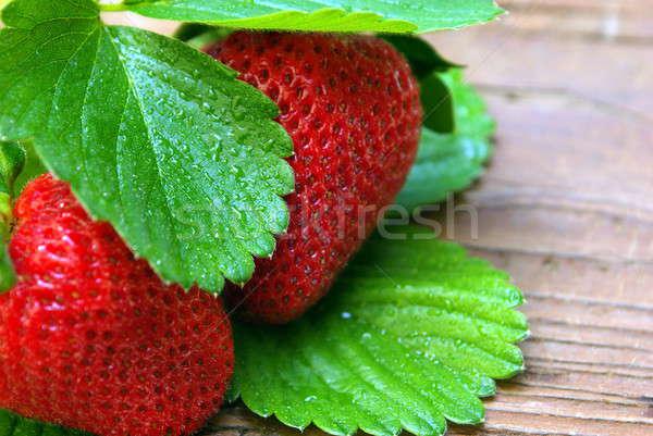Two Glistining Strawberries On Weathered Wood Stock photo © bendicks