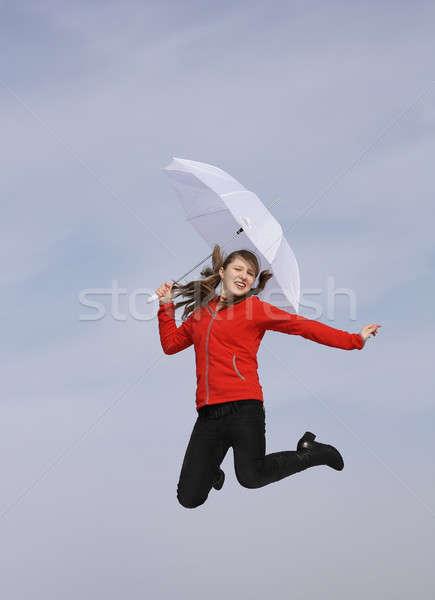 Fille heureuse parapluie fille blanche sautant ciel Photo stock © bendzhik