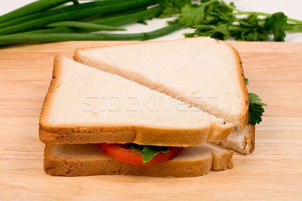 Sandviçler lezzetli sosis domates otlar grup Stok fotoğraf © bendzhik