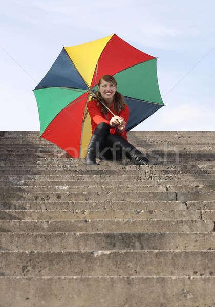счастливая девушка зонтик улыбаясь девушки сидят шаги Сток-фото © bendzhik