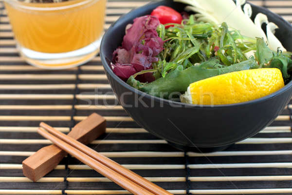 Sushi salata arka plan restoran kırmızı plaka Stok fotoğraf © bendzhik