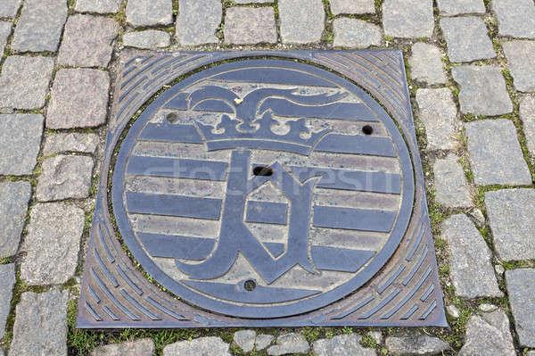 Bruges emblem on manhole cover Stock photo © benkrut