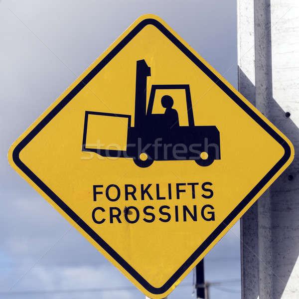 Sarı yol işareti kutup gökyüzü fabrika Stok fotoğraf © benkrut
