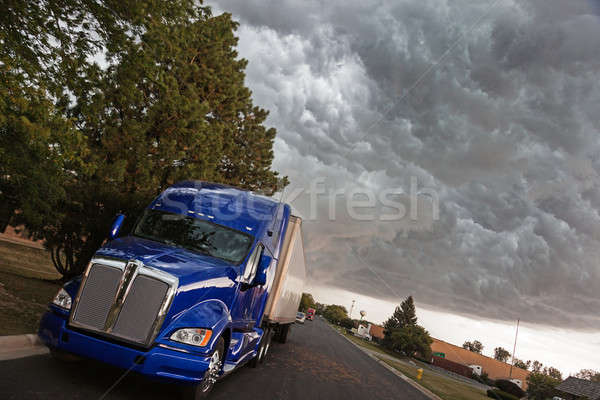 Semi Truck under heavy clouds Stock photo © benkrut