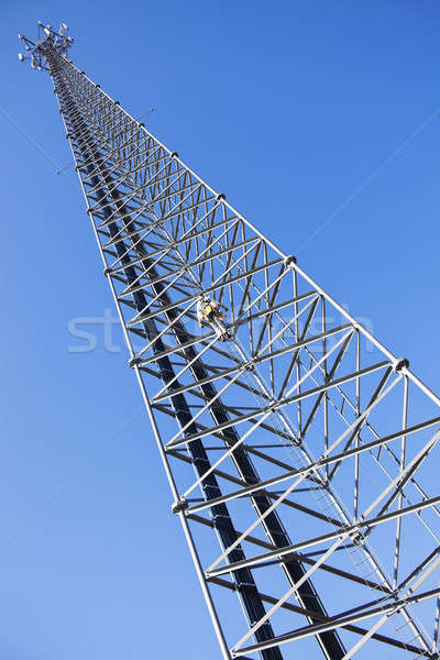 Climber ascending the cellular tower Stock photo © benkrut