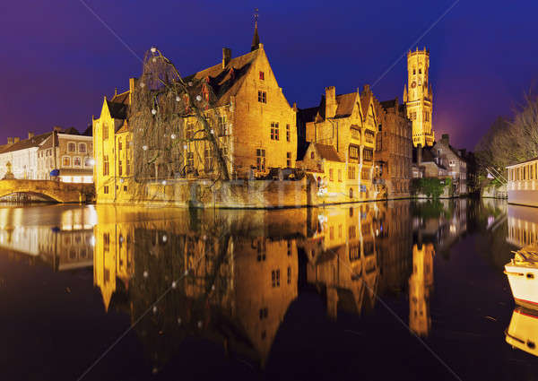 Belfry of Bruges reflected in the canal Stock photo © benkrut