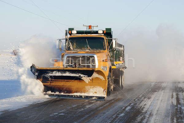 Snow plower on rural road Stock photo © benkrut