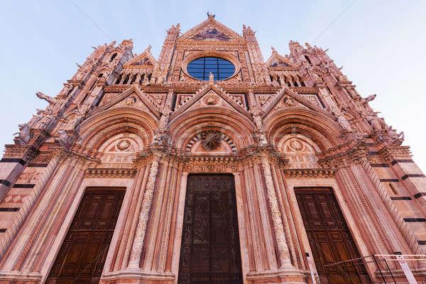 Siena Cathedral at sunrise Stock photo © benkrut
