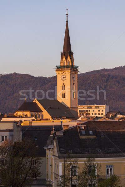 Igreja cidade pôr do sol azul viajar linha do horizonte Foto stock © benkrut