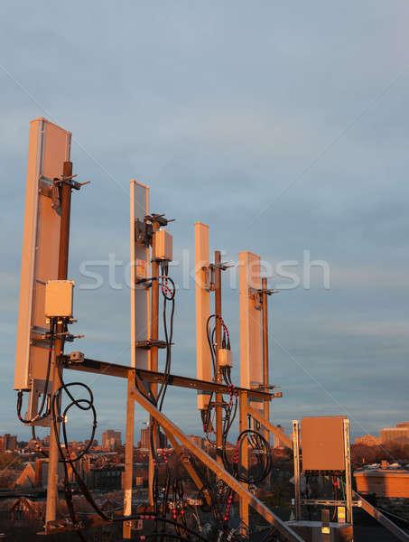 Celular techo caliente puesta de sol luz tecnología Foto stock © benkrut