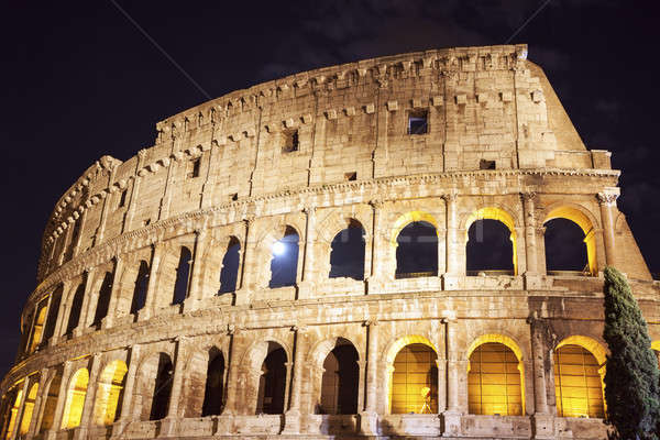 Coliseo noche luna llena Roma cielo ciudad Foto stock © benkrut