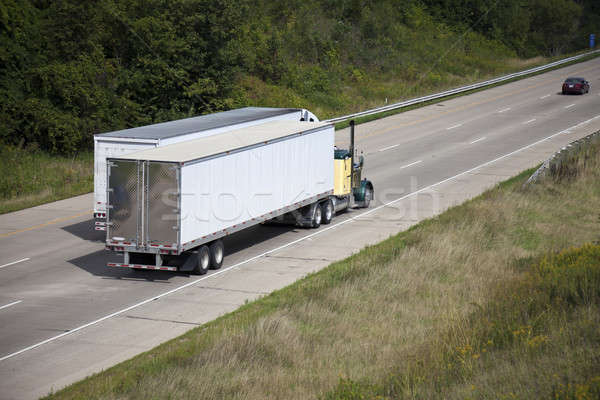 Two semi trucks on the highway Stock photo © benkrut