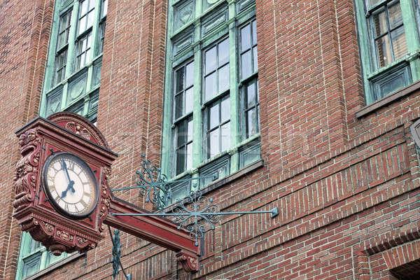 Historische architectuur oude klok baksteen gebouw stad Stockfoto © benkrut