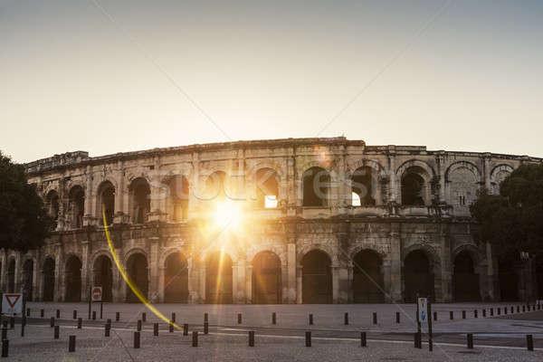 Arena nascer do sol edifício urbano linha do horizonte panorama Foto stock © benkrut
