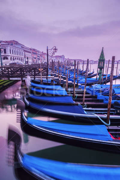 Gondolas in Venice at sunrise  Stock photo © benkrut