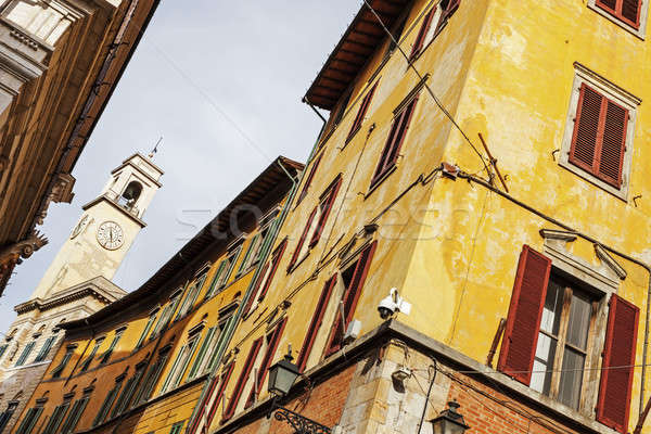 Colorful Pisa architecture with the clock tower Stock photo © benkrut