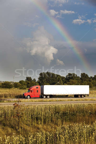 Semi truck driving under the rainbow Stock photo © benkrut