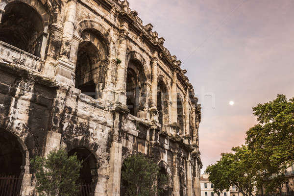 Arena of Nimes at sunrise and moonset Stock photo © benkrut