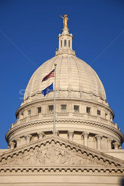 State Capitol Building with US and Wisconsin flags Stock photo © benkrut