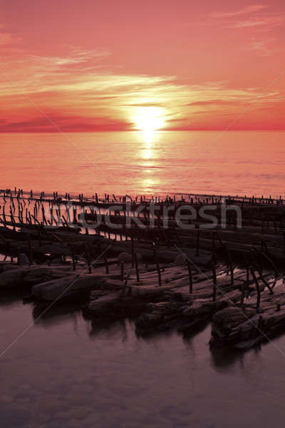 Navio destruir pôr do sol rochas Foto stock © benkrut