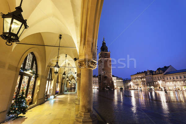 Krakow Rathaus Tower seen from arches of Cloth Hall Stock photo © benkrut